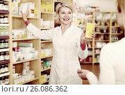 Купить «Happy woman recommending care products», фото № 26086362, снято 15 марта 2017 г. (c) Яков Филимонов / Фотобанк Лори