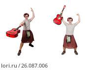Купить «Scotsman playing guitar isolated on white», фото № 26087006, снято 9 апреля 2014 г. (c) Elnur / Фотобанк Лори