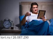 Купить «Desperate man divorced in bed», фото № 26087290, снято 28 декабря 2016 г. (c) Elnur / Фотобанк Лори