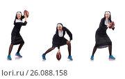 Купить «Pretty nun with rugby ball isolated on white», фото № 26088158, снято 1 декабря 2012 г. (c) Elnur / Фотобанк Лори