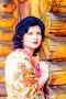 Молодая женщина в платке на фоне деревянного дома, фото № 26094982, снято 10 апреля 2014 г. (c) Сергеев Валерий / Фотобанк Лори