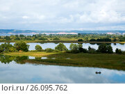 Beautiful landscape with islands on Volga river and a boat, Tatarstan, Russia (2014 год). Стоковое фото, фотограф Жукова Юлия / Фотобанк Лори
