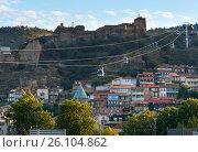 Купить «View on cableway under roofs of Old city at sunset. Tbilisi, Georgia», фото № 26104862, снято 25 сентября 2016 г. (c) Elena Odareeva / Фотобанк Лори