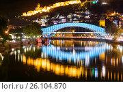 Купить «Bridge of Peace at night in Tibilisi, Georgia», фото № 26104870, снято 26 сентября 2016 г. (c) Elena Odareeva / Фотобанк Лори