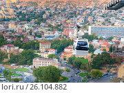 Купить «View on car of cableway under roofs of Old city Tbilisi, Georgia», фото № 26104882, снято 27 сентября 2016 г. (c) Elena Odareeva / Фотобанк Лори
