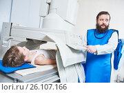Купить «Radiology specialist at work. male radiologist in protective wear», фото № 26107166, снято 16 февраля 2017 г. (c) Дмитрий Калиновский / Фотобанк Лори