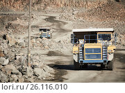 Купить «Huge dump truck transporting granite rock or iron ore», фото № 26116010, снято 8 сентября 2016 г. (c) Дмитрий Калиновский / Фотобанк Лори