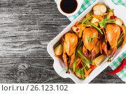 Купить «Quails baked with vegetables, top view», фото № 26123102, снято 27 октября 2015 г. (c) Oksana Zh / Фотобанк Лори