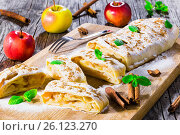 Купить «Baked homemade apple strudel with powdered sugar and mint leaves», фото № 26123270, снято 20 июля 2018 г. (c) Oksana Zh / Фотобанк Лори