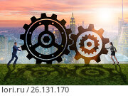 Купить «Businesspeople in teamwork example with cogwheels», фото № 26131170, снято 21 августа 2019 г. (c) Elnur / Фотобанк Лори