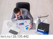 Купить «View from top on businessman working on business charts», фото № 26135442, снято 30 января 2017 г. (c) Elnur / Фотобанк Лори