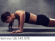 Купить «woman doing push-ups in gym», фото № 26141570, снято 12 декабря 2015 г. (c) Syda Productions / Фотобанк Лори