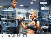 Купить «man and woman flexing muscles on gym machine», фото № 26141678, снято 19 апреля 2015 г. (c) Syda Productions / Фотобанк Лори