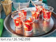 Купить «strawberry in plastic cups at street market», фото № 26142098, снято 7 февраля 2015 г. (c) Syda Productions / Фотобанк Лори