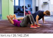 Купить «woman with man doing sit ups and push ups in gym», фото № 26142254, снято 19 февраля 2017 г. (c) Syda Productions / Фотобанк Лори