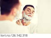 Купить «man shaving beard with razor blade at bathroom», фото № 26142318, снято 15 января 2016 г. (c) Syda Productions / Фотобанк Лори