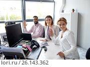 Купить «business team waving hands at office», фото № 26143362, снято 1 октября 2016 г. (c) Syda Productions / Фотобанк Лори