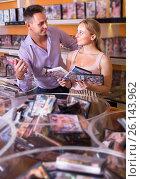 Купить «Couple choosing disks with video in sex shop», фото № 26143962, снято 19 февраля 2020 г. (c) Яков Филимонов / Фотобанк Лори