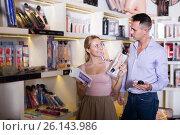Купить «Young family buying sex toys together in store», фото № 26143986, снято 19 февраля 2020 г. (c) Яков Филимонов / Фотобанк Лори