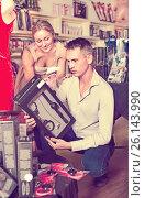 Couple choosing erotic toys in sex shop. Стоковое фото, фотограф Яков Филимонов / Фотобанк Лори