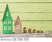 Купить «paper house on green wooden background», фото № 26158150, снято 28 апреля 2017 г. (c) Майя Крученкова / Фотобанк Лори