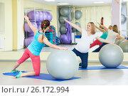 Купить «pregnant woman doing fitness ball exercise with coach», фото № 26172994, снято 3 марта 2017 г. (c) Дмитрий Калиновский / Фотобанк Лори