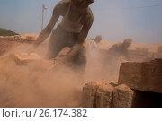 Купить «DHAKA, BANGLADESH - APRIL 29 : Workers working in bricksfield in Dhaka, Bangladesh on April 29, 2017.About 11,000 brickfields are continuing in Bangladesh...», фото № 26174382, снято 29 апреля 2017 г. (c) age Fotostock / Фотобанк Лори