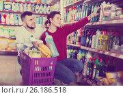 Купить «two attentive adult people in good spirits selecting detergents in the store», фото № 26186518, снято 14 марта 2017 г. (c) Яков Филимонов / Фотобанк Лори