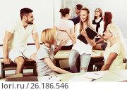 Купить «students communicating», фото № 26186546, снято 22 марта 2019 г. (c) Яков Филимонов / Фотобанк Лори