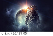 Astronaut in outer space. Mixed media. Стоковое фото, фотограф Sergey Nivens / Фотобанк Лори