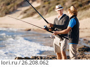 Купить «Senior man fishing with his grandson», фото № 26208062, снято 15 апреля 2015 г. (c) Sergey Nivens / Фотобанк Лори
