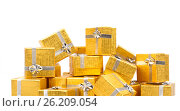 Close up of a pile of gold gifts on white, фото № 26209054, снято 18 августа 2012 г. (c) Tatjana Romanova / Фотобанк Лори