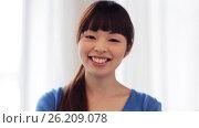 Купить «happy smiling asian young woman», видеоролик № 26209078, снято 22 марта 2017 г. (c) Syda Productions / Фотобанк Лори