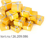 Close up of a pile of gold gifts on white, фото № 26209086, снято 18 августа 2012 г. (c) Tatjana Romanova / Фотобанк Лори