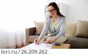 Купить «woman with money, papers and calculator at home», видеоролик № 26209262, снято 22 августа 2019 г. (c) Syda Productions / Фотобанк Лори