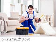 Купить «The furniture repairman working in store», фото № 26213690, снято 23 марта 2017 г. (c) Elnur / Фотобанк Лори