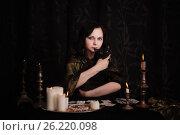 Купить «Young woman with divination cards in room», фото № 26220098, снято 5 марта 2017 г. (c) Майя Крученкова / Фотобанк Лори