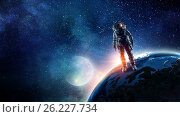 Купить «Astronaut in outer space. Mixed media», фото № 26227734, снято 19 марта 2014 г. (c) Sergey Nivens / Фотобанк Лори