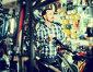 Man considers bicycle handlebar in store, фото № 26230414, снято 27 мая 2017 г. (c) Яков Филимонов / Фотобанк Лори