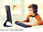 Купить «boy with computer and headphones at home», фото № 26245830, снято 24 октября 2015 г. (c) Syda Productions / Фотобанк Лори