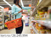 Купить «woman with food basket at grocery or supermarket», фото № 26245994, снято 2 ноября 2016 г. (c) Syda Productions / Фотобанк Лори