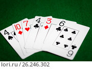 Купить «poker hand of playing cards on green casino cloth», фото № 26246302, снято 15 марта 2017 г. (c) Syda Productions / Фотобанк Лори