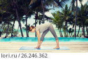 Купить «woman making yoga intense stretch pose on mat», фото № 26246362, снято 13 ноября 2015 г. (c) Syda Productions / Фотобанк Лори