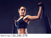 Купить «woman with expander exercising in gym», фото № 26246378, снято 12 декабря 2015 г. (c) Syda Productions / Фотобанк Лори