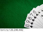 Купить «poker hand of playing cards on green casino cloth», фото № 26246442, снято 15 марта 2017 г. (c) Syda Productions / Фотобанк Лори