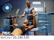 Купить «man and woman with barbell flexing muscles in gym», фото № 26246530, снято 19 апреля 2015 г. (c) Syda Productions / Фотобанк Лори