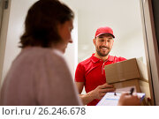 Купить «deliveryman and customer with parcel boxes at home», фото № 26246678, снято 3 декабря 2016 г. (c) Syda Productions / Фотобанк Лори