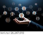 Купить «close up of businessman hand with contacts icons», фото № 26247010, снято 6 сентября 2016 г. (c) Syda Productions / Фотобанк Лори