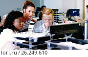 Купить «Executives working together at the desk q», видеоролик № 26249610, снято 11 июля 2020 г. (c) Wavebreak Media / Фотобанк Лори