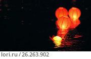 Купить «Floating lighting Paper Lanterns On Water - romantic festival», видеоролик № 26263902, снято 19 февраля 2019 г. (c) Константин Шишкин / Фотобанк Лори